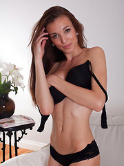 Bonny O makes a titillating debut series, brandishing her black robe and stripping off her matching lingerie before fully showcasing her long and slender body.