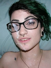 Green-haired and bespectacled slut lets a hung fellow cum on her pretty face